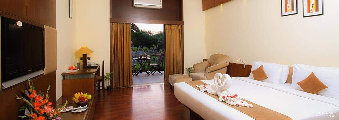 Deluxe suite with king size bed overlooking balcony - Deluxe suites in Mysore - duplex rooms near me