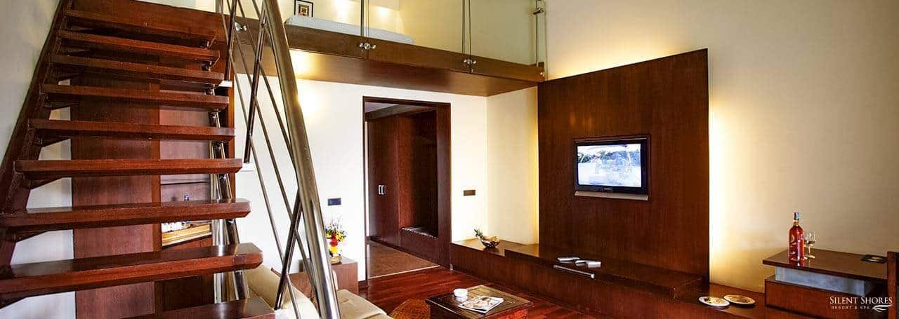 Duplex suite with staircase and TV - best hotel rooms - Silent Shores - best resort in mysore
