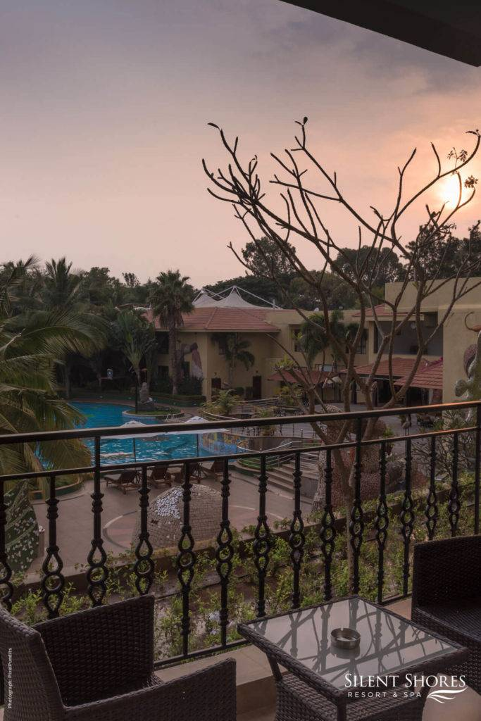 Private balcony at Superior rooms during sunset at SIlent Shores - 5 Star resort in Mysore - The best spa resort in Mysore