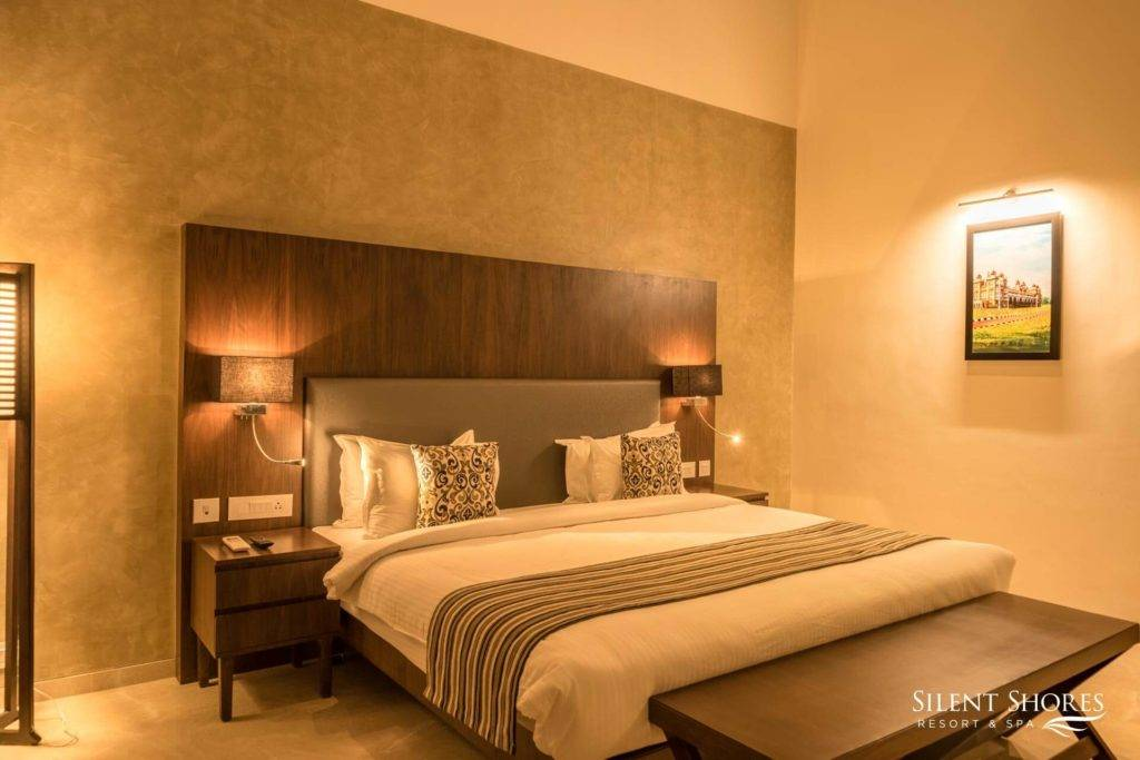 King-size bed in Superior rooms at Silent Shores Resort & Spa - Luxury superior rooms in Mysore - 5 star resort in Mysore